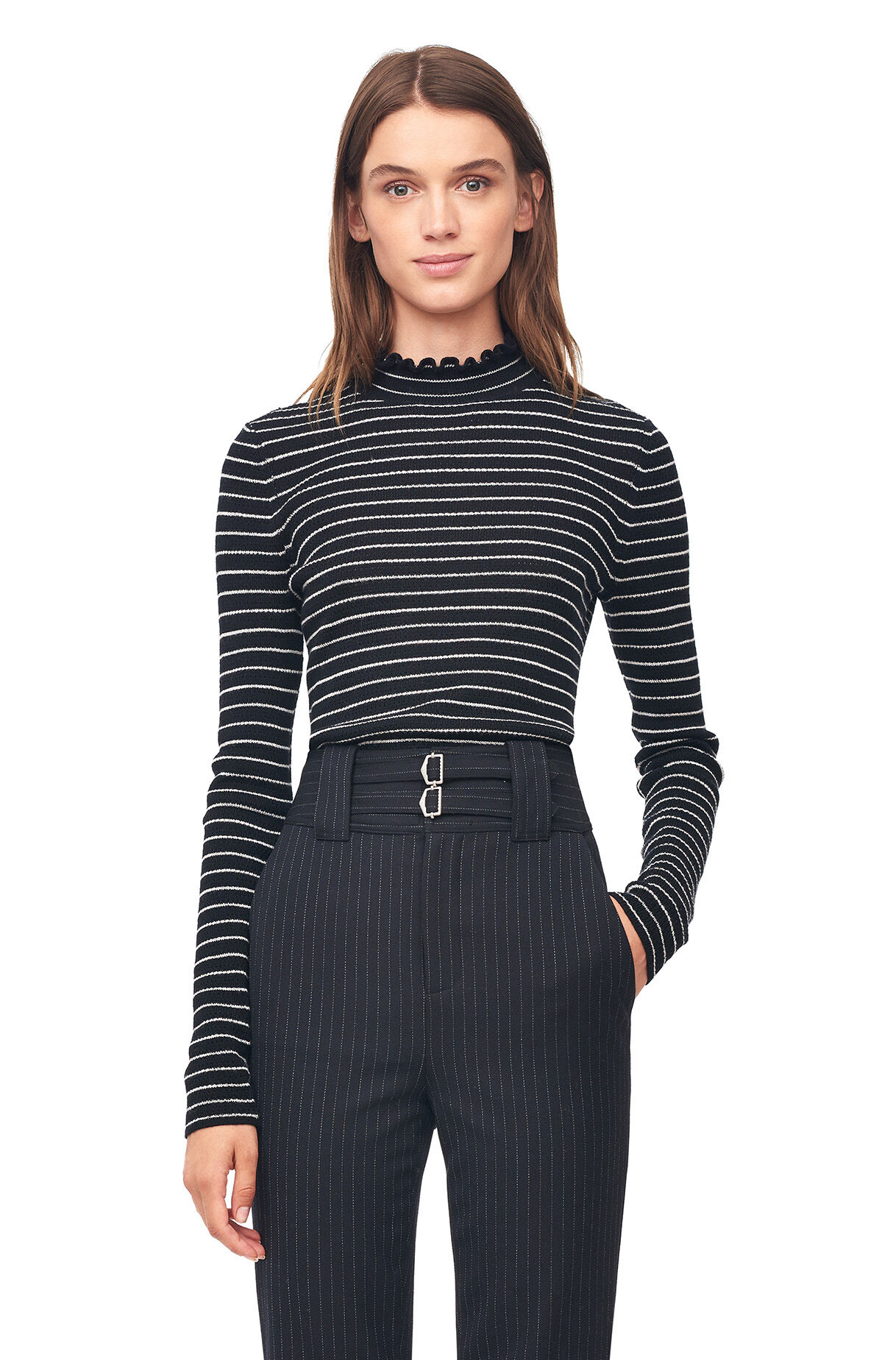 There's nothing more classic than a merino turtleneck and a slim pant. Just ask the French. Semifitted. Hits at hip. Merino wool in a gauge knit. Rib trim at neck, .