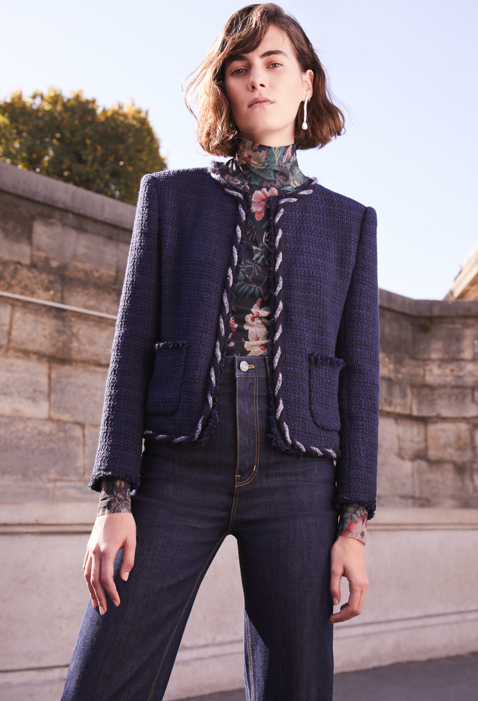 Model wearing tweed blazer and jeans