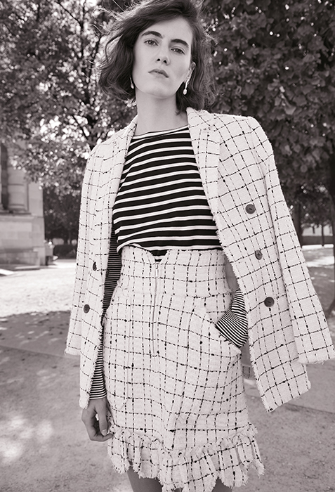 Model in tweed blazer and skirt